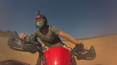 The guy rides a Quad bike in Thailand on the sand in the career Stock Footage