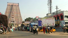 Tiruchirappalli - Street view with people and traffic in front of Hindu complex. Stock Footage