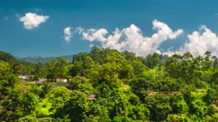 Green hill village view time lapse with blue sky and cluds. Ella. 4K Stock Footage