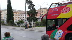 City tour bus and street traffic in Rome - Italy travel weekend - stock footage