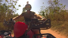 The guy rushes through the Thai jungle and the sand on the ATV quad bike Stock Footage