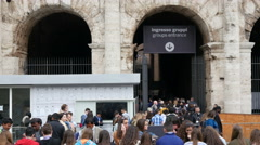 Crowd tourists stand in a queue by Entrance of Colosseum - Rome Italy Coliseum Stock Footage