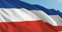 Beautiful looping flag blowing in wind: Serbia Montenegro - stock footage