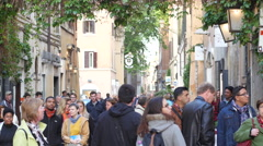 Crowd tourists people walking Italy Rome street traveling visiting Eternal City Stock Footage