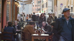 Tourists walking sitting in street cafes and restaurants in Rome Italy Stock Footage