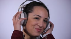 Beautiful Girl Listening To Music, Isolated on White - stock footage
