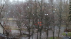 Snow falling on the background of the street Stock Footage