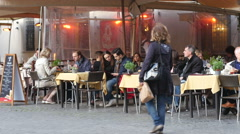 People tourists rest eat and drink in cozy street restaurant visiting Rome Italy Stock Footage