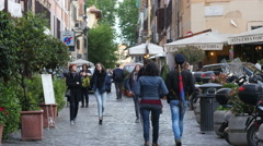People tourists walking streets of Rome Italy - weekend travel to Europe Stock Footage