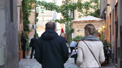 Couple tourists walking streets of Rome Italy - weekend travel to Europe Stock Footage
