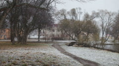 Snow falling on the background of the park Stock Footage