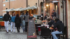 People tourists rest eat and drink in cozy cafes and restaurants of Rome Italy Stock Footage