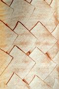 Copper rhomb on a white wall Stock Photos
