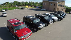 Flying over the row of Hummer cars on parking lot Stock Footage