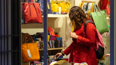 People shopping in Italy Rome interior of a fashionable bags shop Stock Footage