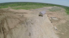 Tank on the finish during maneuvers, aerial shot - stock footage