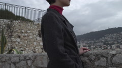 Beautiful woman looking on the city view Stock Footage