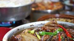 Chinese, Taiwanese street food meat ball soup and pork knuckle - stock footage