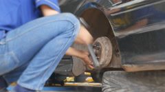 Footage of a man Break disc replacement in car service shop. Stock Footage