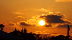 Golden Sunset With Clouds on Roof Stock Footage