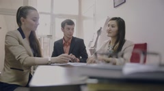 three students communicate young businessman sitting in the office - stock footage