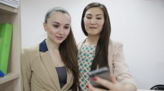 Two young girls student office worker on the phone selfie Stock Footage