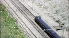 1962: Realistic model train replica crossing bridge exhibit. Stock Footage