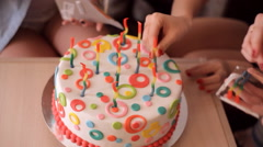 Girls insert candles in the cake Stock Footage