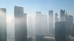 Time lapse of early morning mist clearing over downtown, Doha Stock Footage