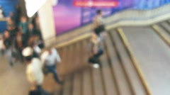 Crowd of people climb the stairs at the metro station, blurred background - stock footage