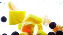 Mixed fruits falling into water in slow motion. Stock Footage
