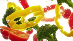 Mixed vegetables stir in the water. Stock Footage
