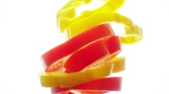 Bell pepper slices float in the water in slow motion. Stock Footage