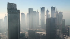 Time lapse of early morning mist clearing over downtown, Doha - stock footage