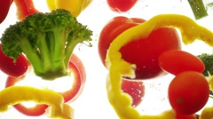 Mixed vegetables stir in the water Stock Footage