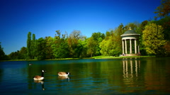 Idyllic garden park with Apollo Temple Nymphenburg Park in Munich Germany Stock Footage