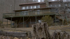 Log home in the woods in the winter daytime - establishing dolly shot Stock Footage