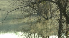 The fog creeps over the water. - stock footage