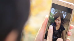 Asian Woman selfie photography with smart phone Stock Footage