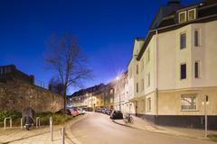A city street in Aachen Burtscheid, Germany with night blue sky. - stock photo