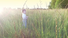 Little toddler in the middle of the field. Stock Footage
