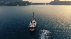 Aerial Video. The drone revolves around a sailboat at sea. N. Stock Footage