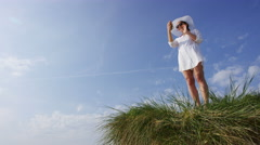 4K Young fashionable woman having a video call on a sunny day at the beach Stock Footage