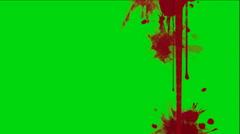 Blood splatter on a green screen Stock Footage