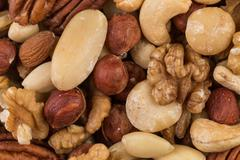 lot of different types of nuts - stock photo