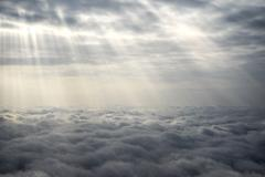 Sun Rays Over The Clouds - stock photo