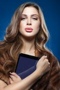 Girl with the tablet. - stock photo