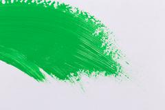 Green stroke of the paint brush Stock Photos