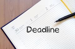 Deadline write on notebook - stock photo