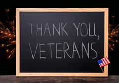 greeting card of handwriting text thank you veterans is written in chalkboard - stock photo